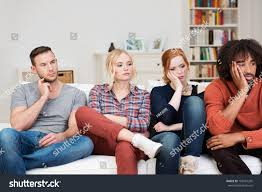 bored bored group multiracial friends relaxing home stock photo