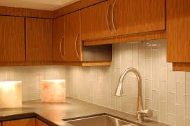 kitchen light wooden cabinet glass ceramic tile backsplash