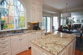 granite countertop burnt orange kitchen cabinets frosted glass