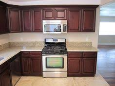 maple cabinets and the backsplash and giallo ornamental