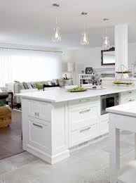 White Kitchen Tile Floor Island Storage Pendant Lights Look Out Into Living Room Jas