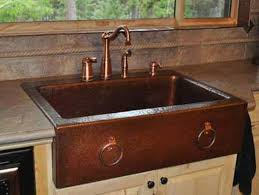 hammered copper kitchen sink with bronze faucet copper kitchen