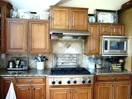 top of kitchen cabinet decor ideas storage above kitchen cabinets decorating above kitchen cabinets