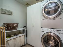 contemporary laundry room with limestone tile floors in tempe az