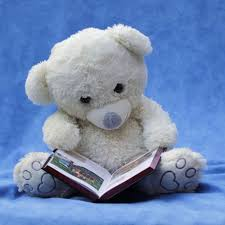 white teddy with opened book photo free stock photo