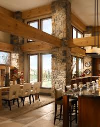 rustic dining room with stone pillars and wood beams dine your