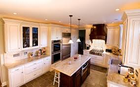 kashmir gold granite countertops with cream cabinets kitchen by