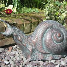 metal snail garden sculpture small garden ornament candle and blue