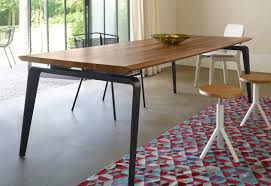 dining table with top made of natural wood odessa ligne roset