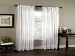 simple window panel curtains framing a window panel curtains