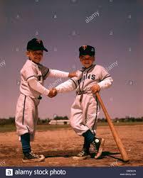 1960 1960s boys playing baseball shaking hands bat uniform friends