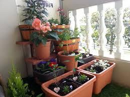 create your own balcony garden design ideas pink dahlias and