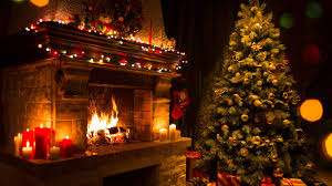 candle light in the fireplace at christmas wallpaper wallpaper