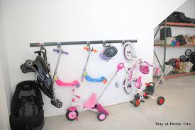 simple mounted kids bike storage from solid metal bar with hooks