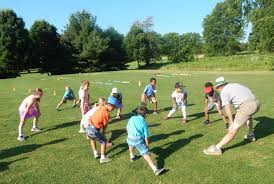 kids learn about golf and learn life skills at the first tee of