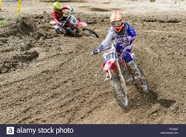 motocross bikes two motorcyclists on motocross bikes are riding on a dirt track