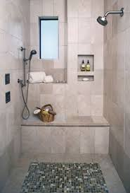 bathroom showers designs a plain tile type w the same accent for both floor and border