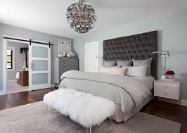 glamorous black tufted headboard and white fur bench for calming