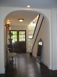 entry with doors espresso hardwood floors mediterranean
