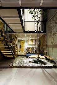 project house small home maximizes space and ventilation using a cool atrium