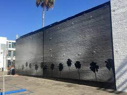 mural of palm trees by noah abrams venice los angeles this beautiful black and white photo realistic mural of palm trees silhouetted is a new addition to the street art scenery along abbot kinney blvd in