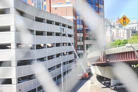 conlin studios a couple of weeks this spring as the cool air became sticky with summer i stood in a basket 35 feet in the air and painted the quackenbush parking garage