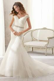 off the shoulder white fit and flare wedding dress with crystal