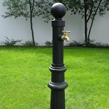 Hose Reel Solution For Yard And Garden Outdoor Faucet Extension Decorative Faucet Post Garden Pinterest Faucet Garden Hose