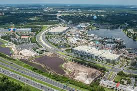 photos disney springs third parking garage construction july located across the street from the lime garage next to town center the third garage will provide up to 3000 additional covered parking spaces