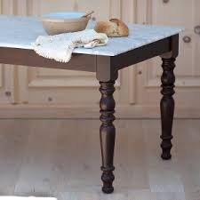 value of marble top tables coastal vintage and farmhouse inspired dining tables the kitchen