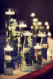 Wedding Centerpieces Floating Candles And Flowers by Submerged Calla Lilly Centerpieces I Could Also Show You A Couple