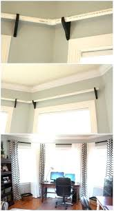 how to hang curtains in a bay window curtain using pipes office windows hang curtains around