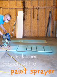 painting the kitchen cabinets with a paint sprayer dans le lakehouse