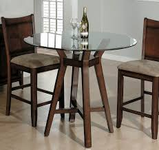 minimalist dining room with round table high glass table set