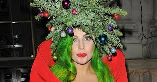 gaga wears a tree with a and baubles on