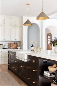white kitchen cabinets with gold pulls gold cabinet pulls and brown cabinets