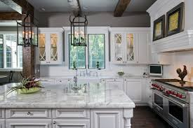 white kitchen cabinets raised panel raised panel white cabinet kitchen with oversize island