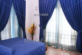 Blue Curtains Bedroom Bedroom With Blue Curtains And Bedspread Stock Photo Ra12119230