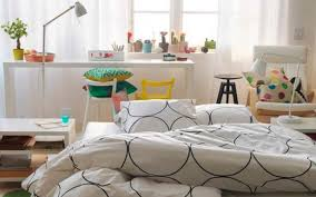ikea bedrom with modern artistic black and white circle pillows