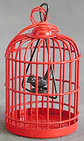 metal bird cage with bird ornament