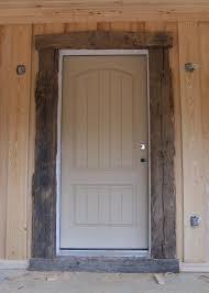 rustic door trim sun room trimmed with old barn wood doors