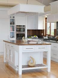 small brown wooden kitchen island with seating neat brown polished