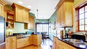 how do you fill the gap between kitchen cabinets and ceiling fill that empty space above your cabinets