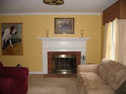 yellow wall paint decorations with white concrete fireplace also