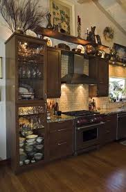 Design Ideas For Kitchen Cabinets How To Decorate The Top Of A Cabinet And How Not To Designed