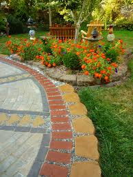 How To Lay Patio Pavers On Dirt by Wow Thats A Busy Garden Creating A Paver And Pebble Mosaic Patio