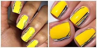 april mani swap with goldnchyld yellow and black graphic nail
