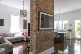 Living Room Red Brick Fireplace A Red Brick Column Makes A Stately Anchor In This Open Concept
