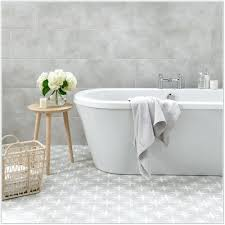 white tile black grout and beautiful patterned floor tilesblue