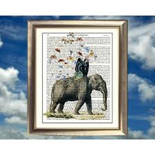 elephant with butterfly wings on antique book page